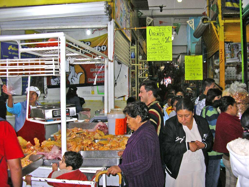 Shoppers crowd the aisles at Morelia's Mercado Independencia in front of one of the poultry vendors. Yes, this is where I buy my chicken, rabbit, etc. whenever I can.