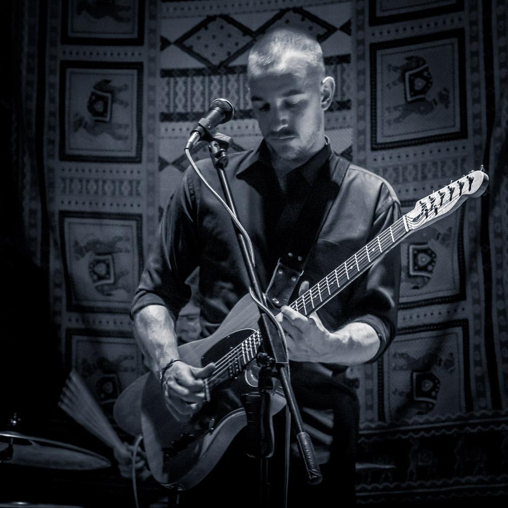 Slim Miller - voice and guitar, Omar Ramirez - Hammond Keyboard, Vic Ramero - Bass and Ivan Ramirez - Drums